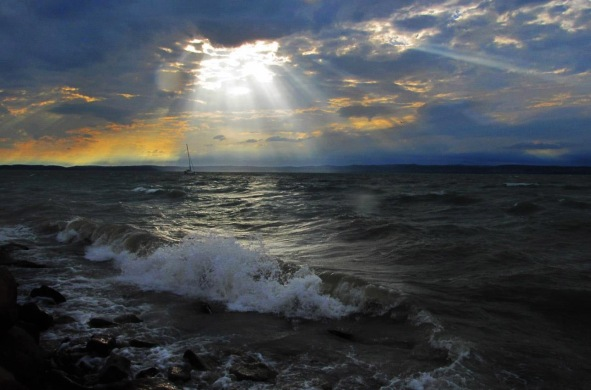 sun-shining-through-clouds-on-the-water